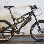Santa Cruz Nomad Carbon in all mountain trim, equipped with Sun Charger Pro Wheels, set up for riding steep terrain.