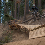 Jason Van Horn launches off the Hemhouser step down on the Gypsy Trail At Northstar.